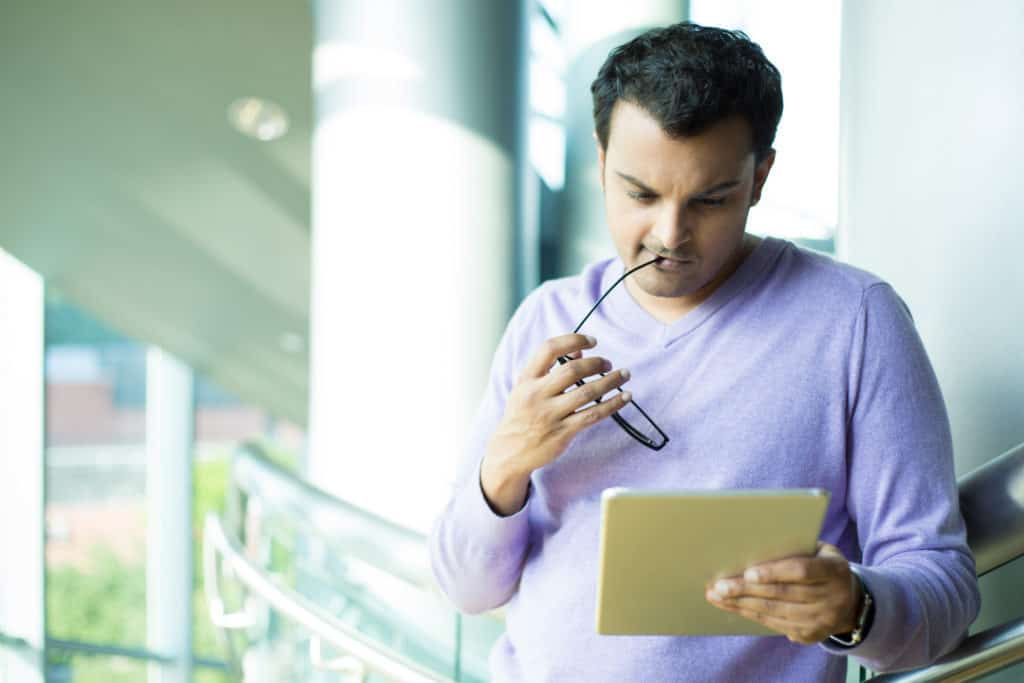 Man holding tablet with his encrypted notebook
