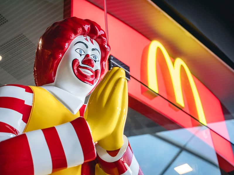 Ronald mcdonald statue in bangkok, thailand mcdonalds restaurant with praying hands in somewhat creepy expression