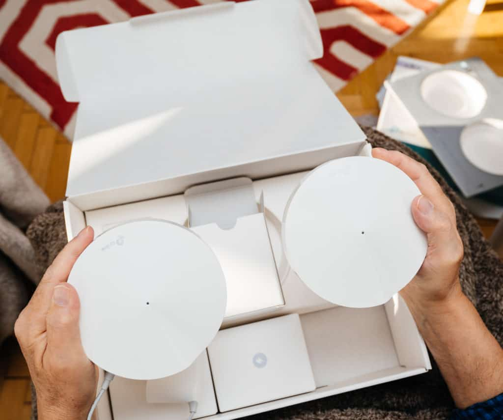 Unboxing a mesh wi-fi system for stronger connection so mobile data can be on or off
