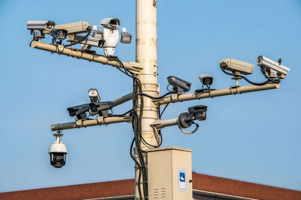 14 cctv cameras crowded on post in bejing illustrating importance of online privacy