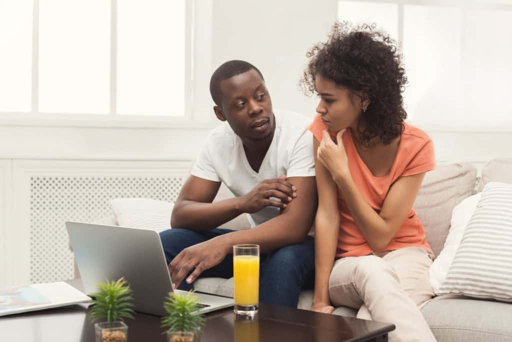Couple at home with a laptop discussing which browser is best for online banking