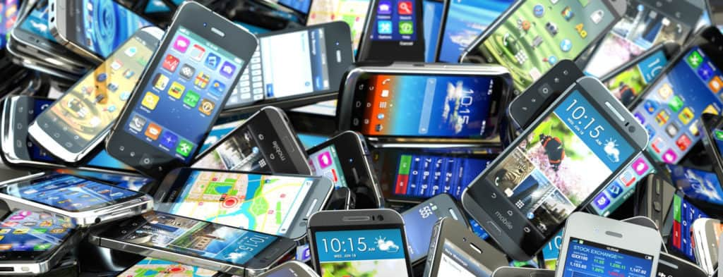 Pile of powered-on smartphones concept of battery life expectancy