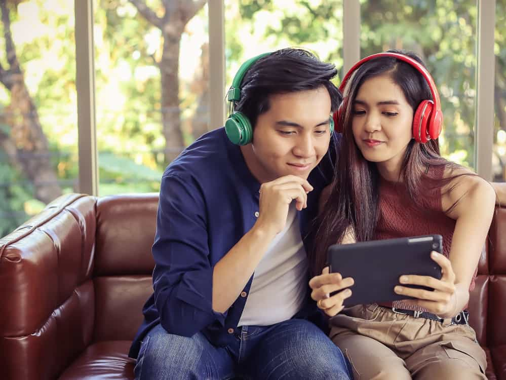 Couple using multiple bluetooth headphones at once