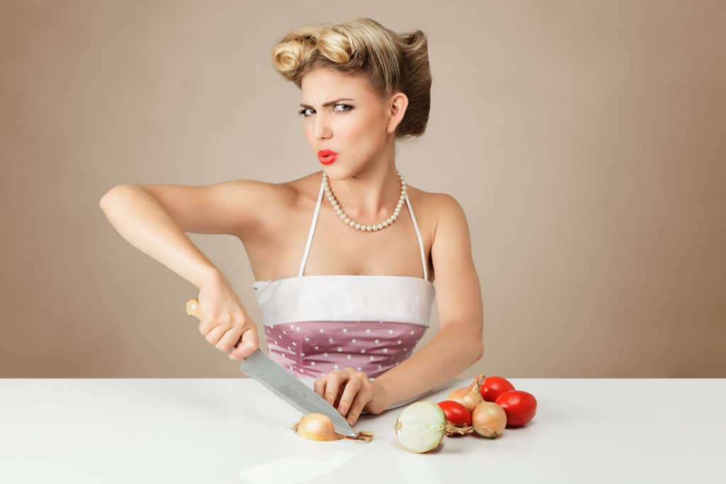 Woman chopping onion teasing photo viewer over knowing about onion over vpn