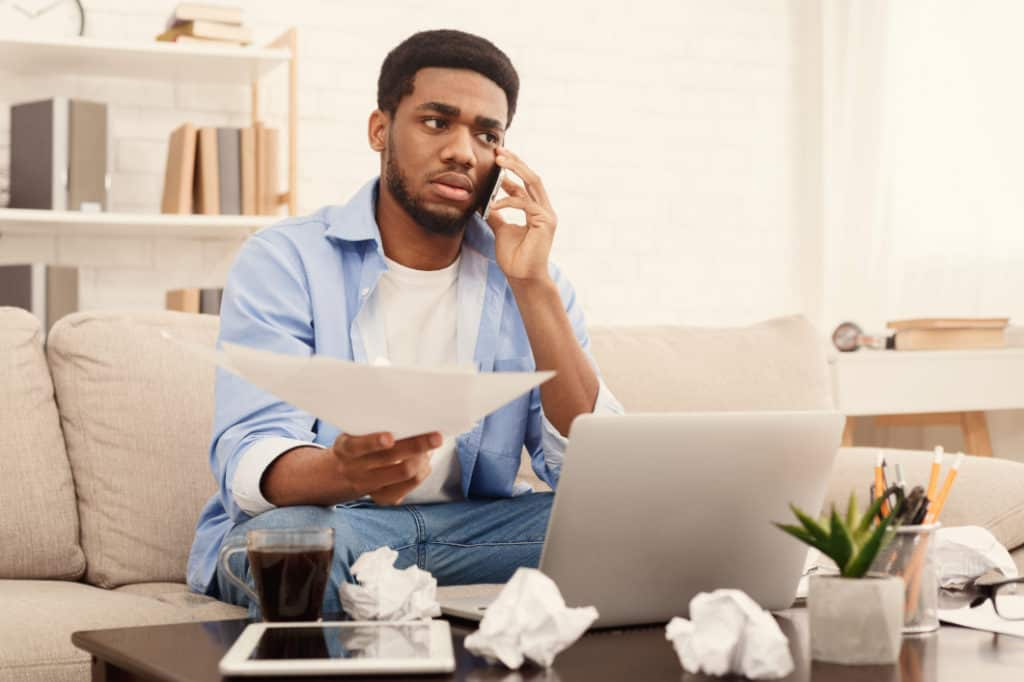 Man calling mobile company worried how to hide numbers on your phone bill