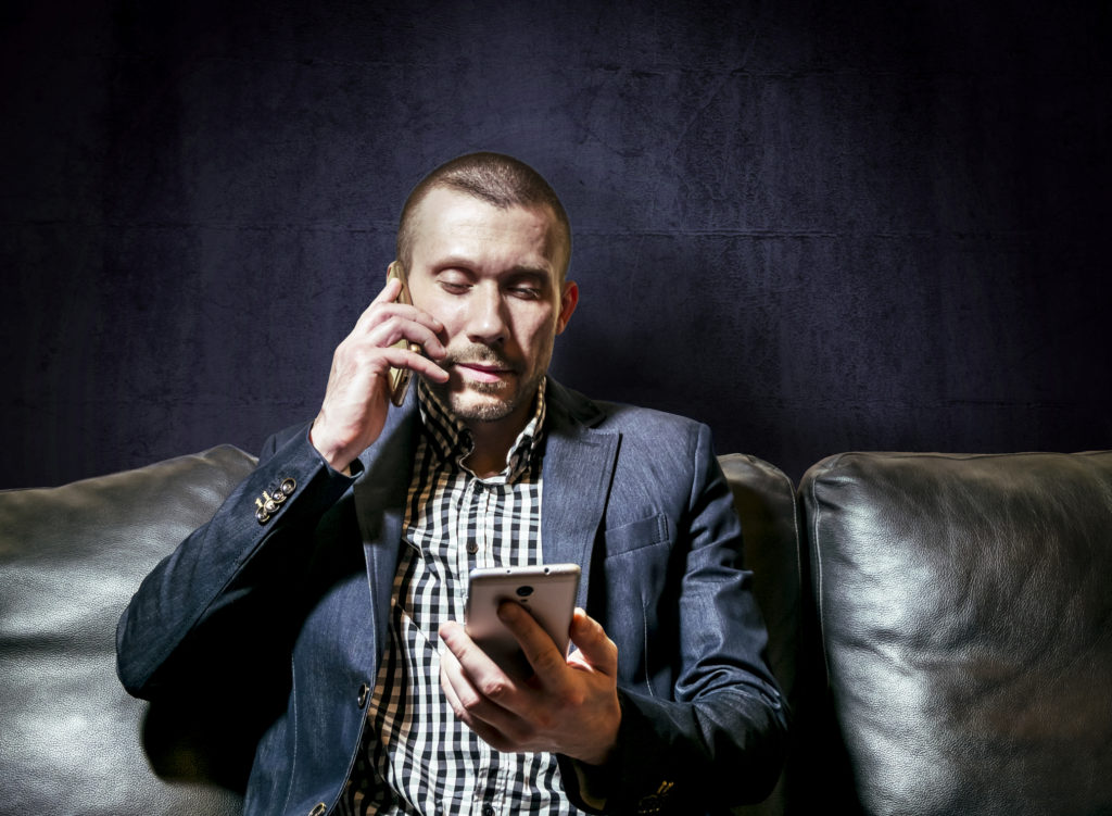 Business man using a personal and work phone