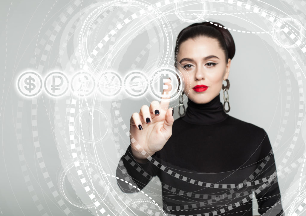 Woman tapping bitcoin symbol knowing what backs cryptocurrency is stronger than fiat